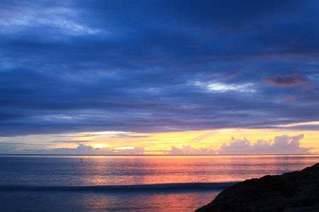 coastal sunset with overcast sky