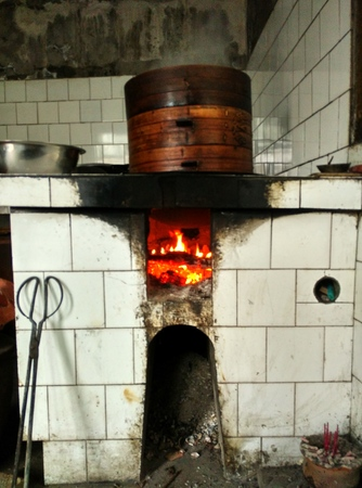 wooden steam vessel on a traditional firewood stove