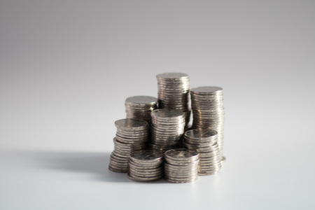stacks of coins of various heights placed together, symbolizing savings or investments