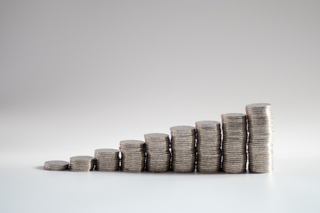 growing steps of coins, symbolizing growing wealth or savings