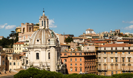 expansive view of Rome with a dome in the foreground