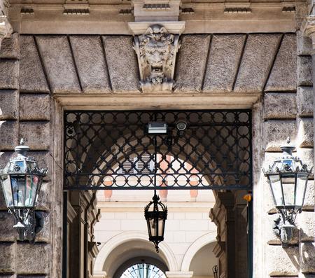 doorway with overhanging sculpture and lanterns