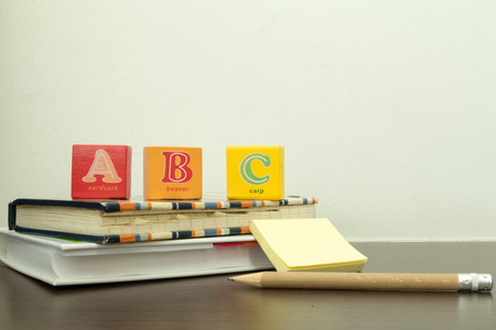 School is back. Some items depicting schooling for young children including backpack, books, pencil, writing materials and ABC blocks