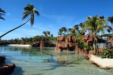 Palms in lagoon with red rocks and waterfalls Stock Photo - 5290959