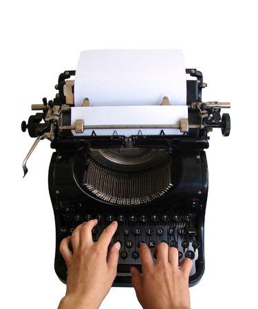 Hands typing on old typewriter