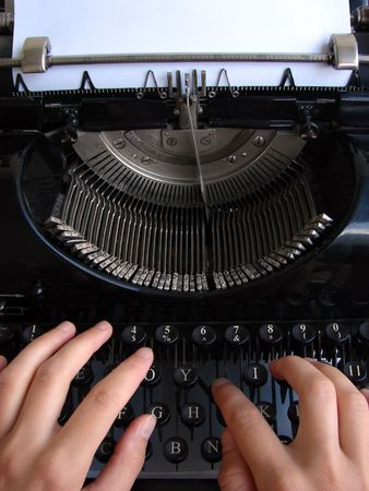 type writer: Hands typing on old typewriter      Stock Photo