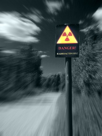 radioactive contamination sign on a forest road photo