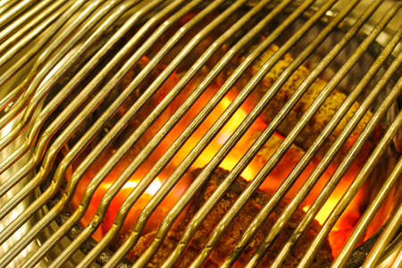 cook griddle: BBQ background, burning charcoal in BBQ grill Stock Photo