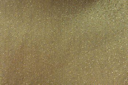 tread: Gold tread on fabric, golden background Stock Photo