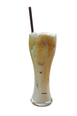 Glass of iced coffee latte with straw isolated on white background, clipping path included. Coffee diffusion texture between milk and coffee layers. Stock Photo