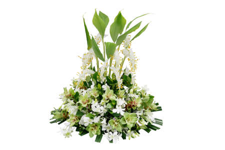 Wedding floral decoration with tropical green leaf plants and exotic flowers (dancing lady ginger, white orchids and Curcuma), floral arrangement bouquet isolated on white with clipping path.