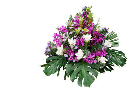 Wedding floral decoration with tropical foliage plants (Monstera, fern, lady palm) and exotic flowers (purple orchids and Curcuma), floral arrangement bouquet isolated on white with clipping path.