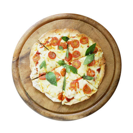 Top view of homemade pizza Italian food, thin-crust pizza pie (Margherita) with mozzarella cheese, tomatoes and basil leaves on wooden plate isolated on white bacground, clipping path included.