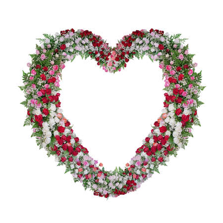 Beautiful heart shaped floral wedding arch with colorful roses flowers and tropical fern leaves, Valentine's day nature backdrop isolated on white background with clipping path.