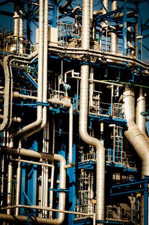 Industrial pipelines and ducts in a modern refinery photo