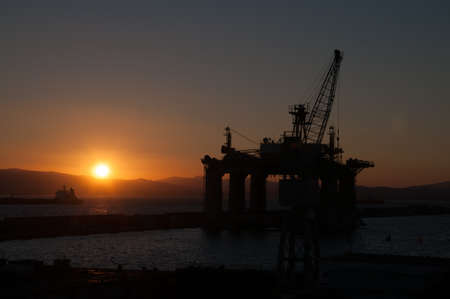 prospection: Sunset in Gibraltar showing a prospection platform over the sea Stock Photo