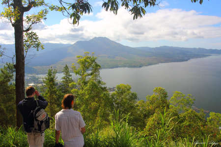 amaze: Two people that amaze by the view of mount Kintamani in Bali Stock Photo