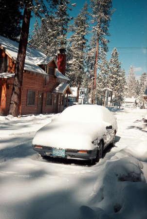 Snow Covered Car In Winter Village Редакционное