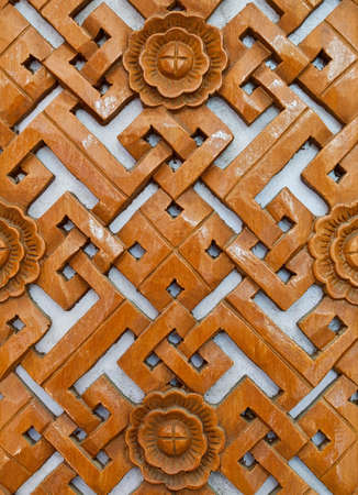 Carving on a piece of wood by Thai craftsmen. Stock Photo - 9279440