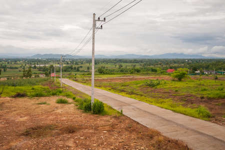 Country road to rural, Thailand photo