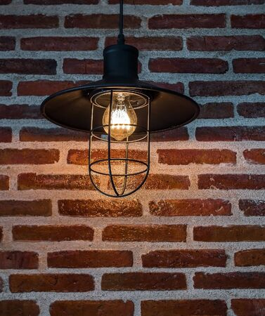 Hanging lamps and brick wall in the kitchen