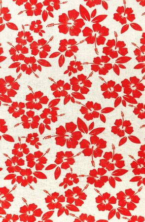 red floral pattern on a fabric backdrop