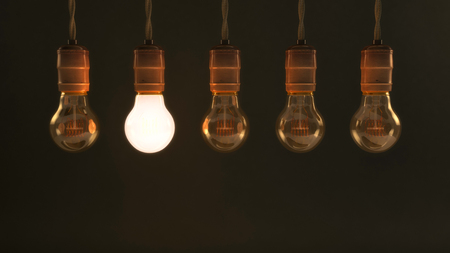 quintet: Five Hanging Vintage Incandescent Light Bulbs with one Illuminated