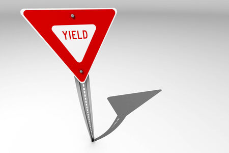 yield sign: A single yield traffic sign over a bright background Stock Photo