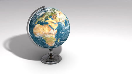 A realistic globe on a chrome pedestal over white featuring Europe, Africa and the Middle East 写真素材