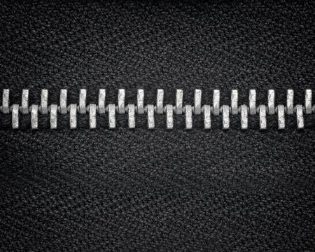 sliver: A macro close up photograph of a closed sliver zipper and black cloth fabric.