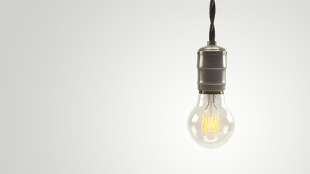 Illuminated 3D rendered vintage lightbulb over a bright white background.  Lots of negative space for graphics and text. Standard-Bild