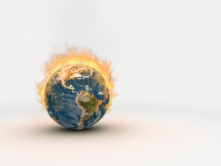 The planet Earth on fire, with flames reaching high.  The fiery globe sits on a white background with lots of negative space for copy or graphics.  3D Illustration.