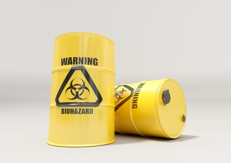 Yellow metal barrels with black biohazard warning sign isolated on white background