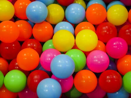 The colorful plastic balls that are in the ball pits for children to play.