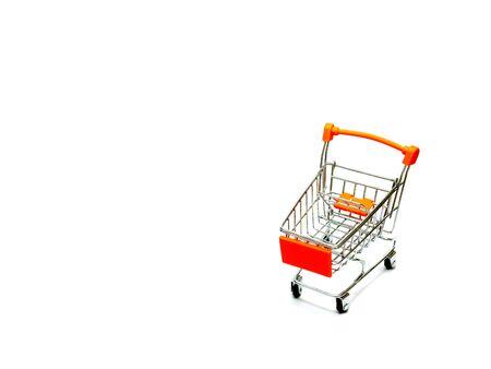 Mini shopping cart isolated on white background. Stock Photo