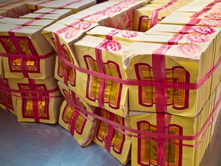 A Stack of gold papers for gods which Currency in Religious Concept of China