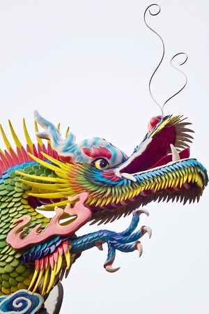 The Colorful Abstract Dragon-decorated of temple in sky Stock Photo