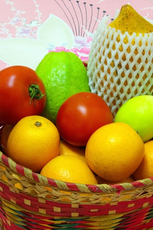 A basket of many kind Delicious fruit Stock Photo - 13319114