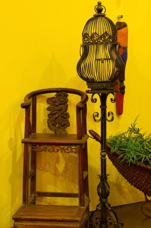 The Still life Decoration with Antique chair and Birdcage Indoor photo