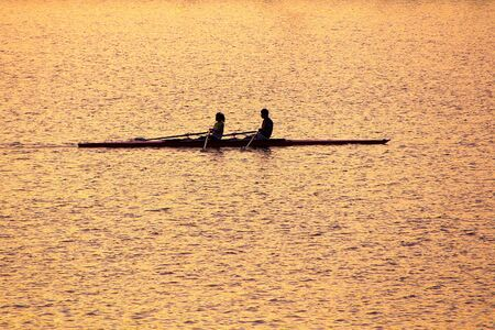 The Sketch of twoTraining rowers in Gold amidst at Dusk