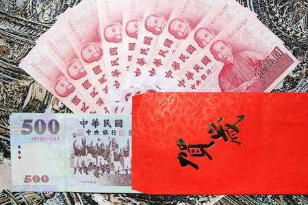 Taiwan Dollar and the New Year red envelope with Chinese Congratulations language