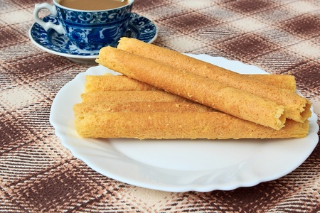 The Desserts with Egg rolls and coffee on Plate
