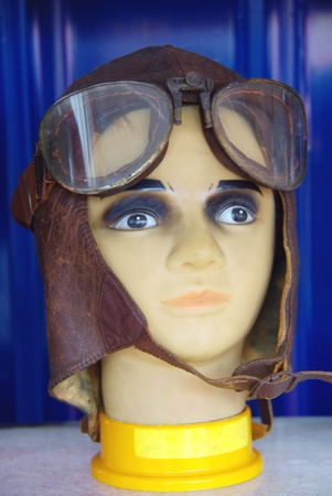 An Exhibition of Antique flight equipment with Flight cap and Goggle Editorial