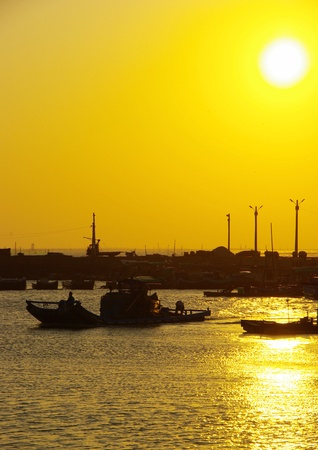 The Scenery of fishing port in Golden Sunset Stock Photo
