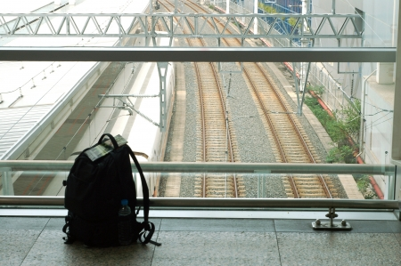 the railway and a Backpack in Train station