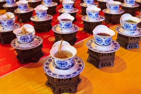 A variety of Arranged Chinese tea with Classical china Cup Editorial