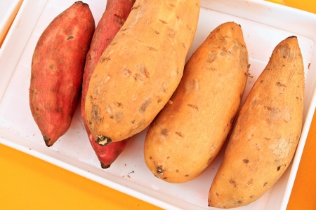 Several Arranged sweet potatos in Plate Stock Photo