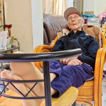 the Napping Chinese elderly who Lying in Chair photo