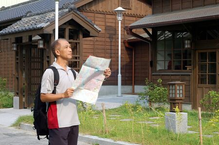 a visitor who seeing map front Japanese-style architecture