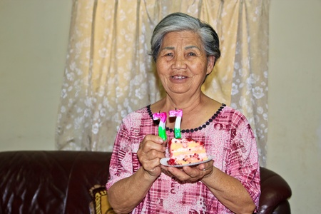 An Old Happy woman with birthday cake for Celebration Stock Photo - 14755079